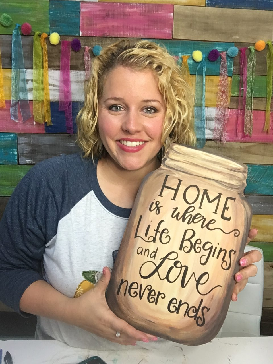 Tamara holding a Rustic Mason Jar Door Hanger