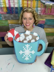 Tamara Bennett with Hot Chocolate Winter Cocoa Painted Door Hanger by Southern ADOORnments