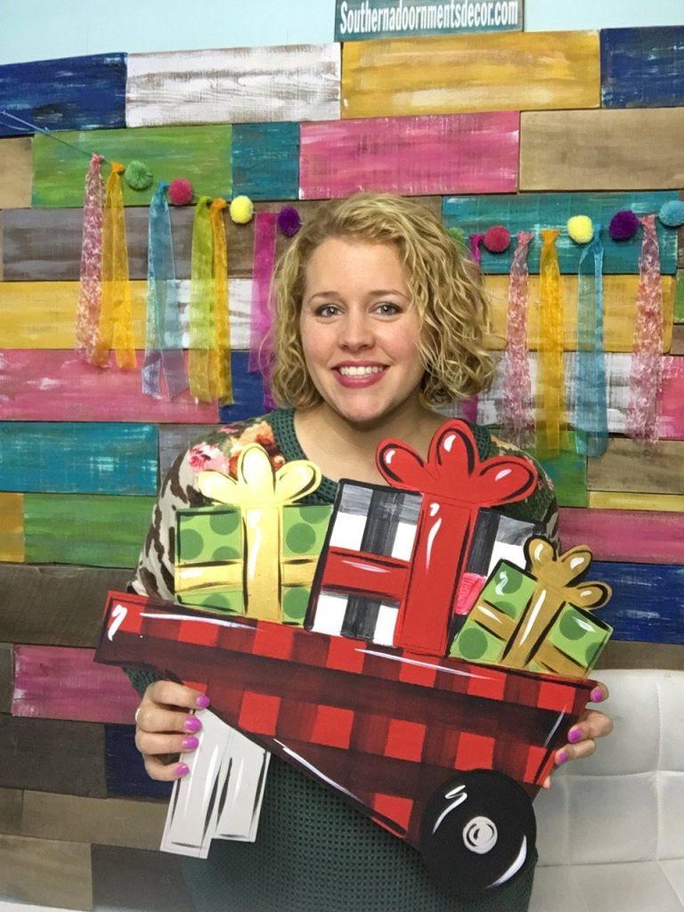 Tamara with Christmas Holiday Wheelbarrow Door Hanger DIY Burlap Buffalo Plaid Bow by Southern ADOORnments