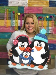 Tamara Bennett with Snowy Penguins Winter Door Hanger by Southern ADOORnments