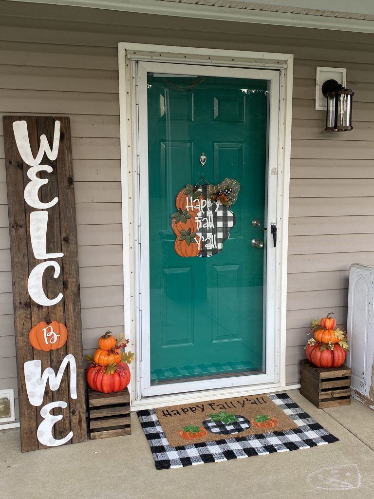 Fall front porch decor for autumn with buffalo plaid door hanger by southern a-door-nments