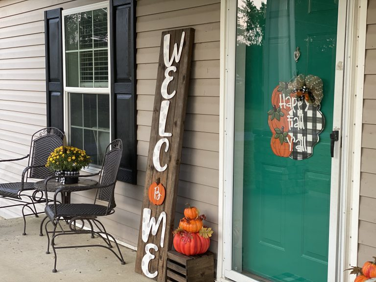 Fall front porch with welcome sign and buffalo plaid by southern a-door-nments
