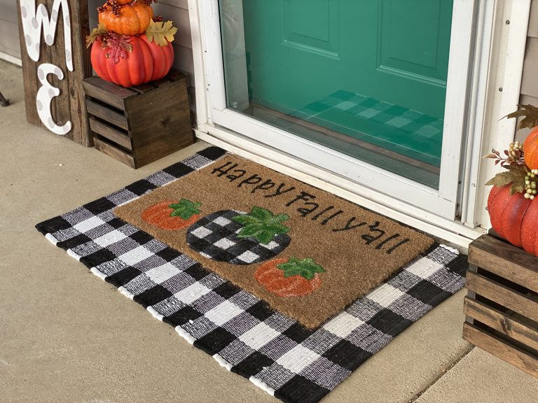 Layered front door mat with black and white buffalo plaid - fall porch decor by southern a-door-nments