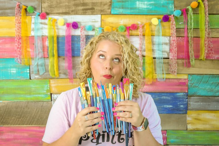 Tamara Bennett Holding Paint Brushes from Southern A-Door-nments