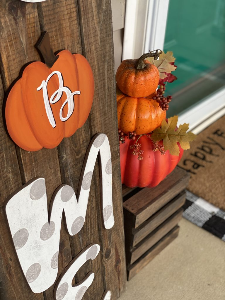 Stacked pumpkins with monogram painted wood welcome sign fall porch decor by southern a-door-nments
