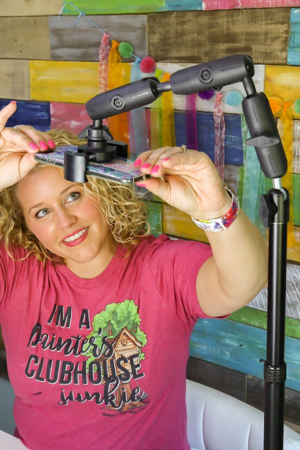 Gift Guide Door Hanger Business Owner Tamara Bennett using an Arkon Mount for her Facebook Live Videos