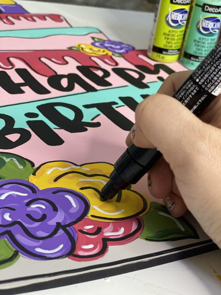 Posca Paint Pens being used on the Happy Birthday Cake Door Hanger