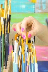 Tamara picking paint brush