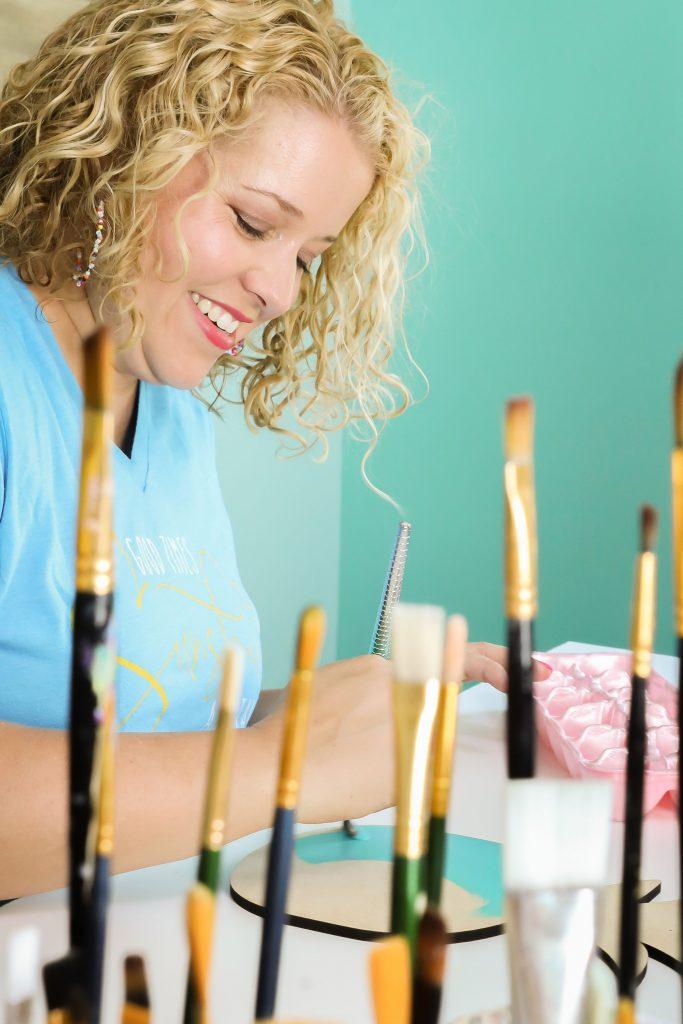 Tamara painting at her desk
