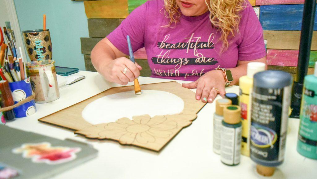 Tamara Bennett painting a Pennant Door Hanger
