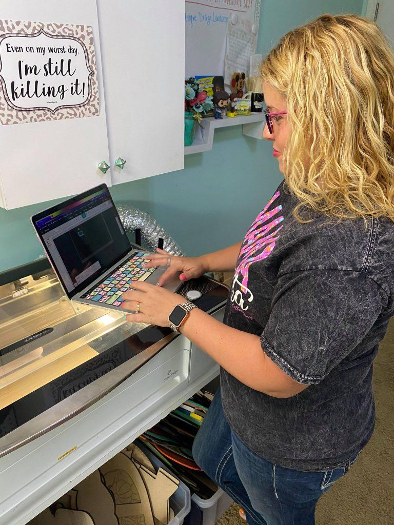 Tamara setting up glowforge on laptop