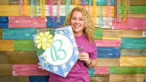 Tamara Bennett with the Floral Pennant Door Hanger