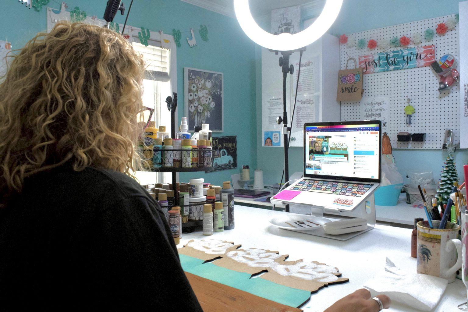 Tamara Bennett sitting behind a computer and ring light on Facebook