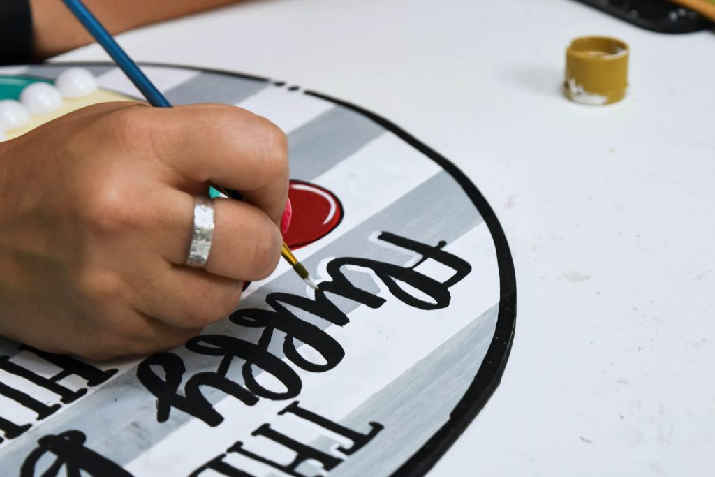 Tamara Bennett Painting the lettering she created with Canva.