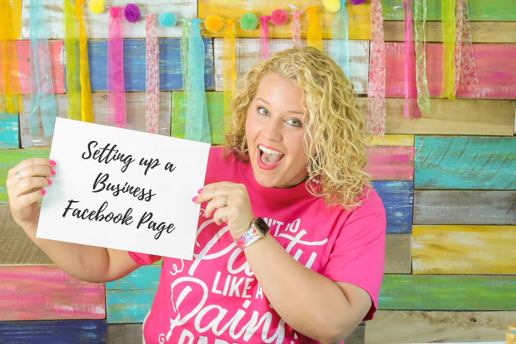 Tamara holding a paper that says Setting up a business facebook page