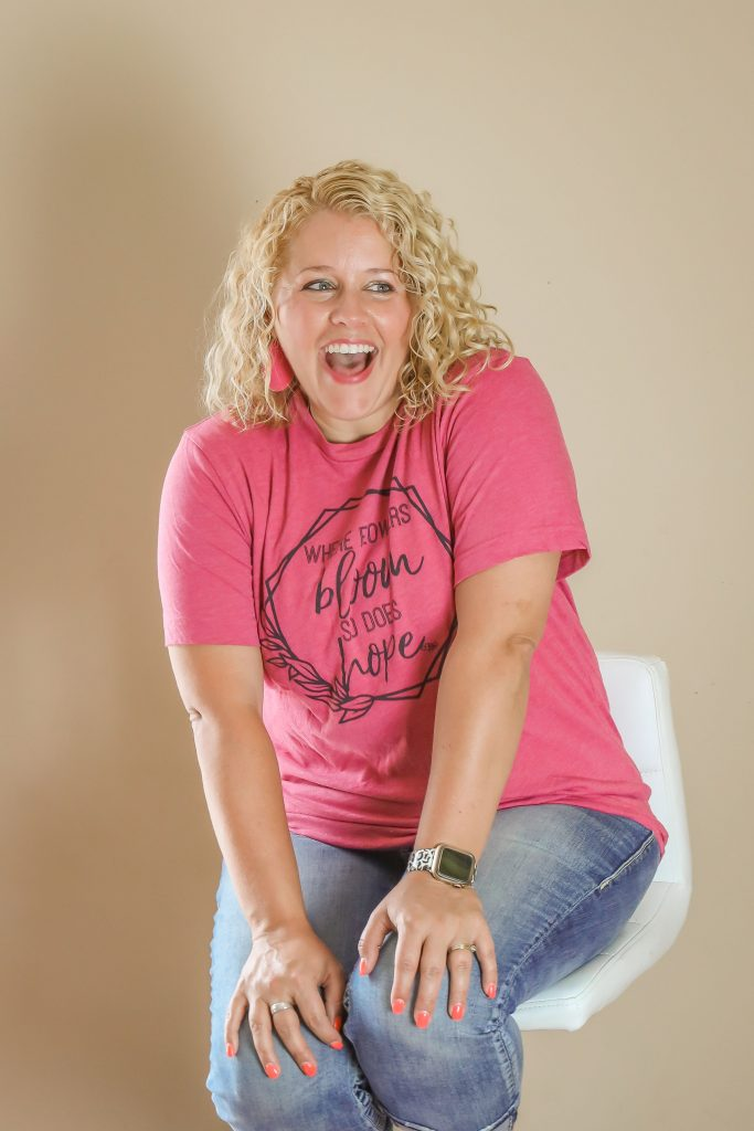 Tamara in a Cute Tshirt Sitting on a Stool