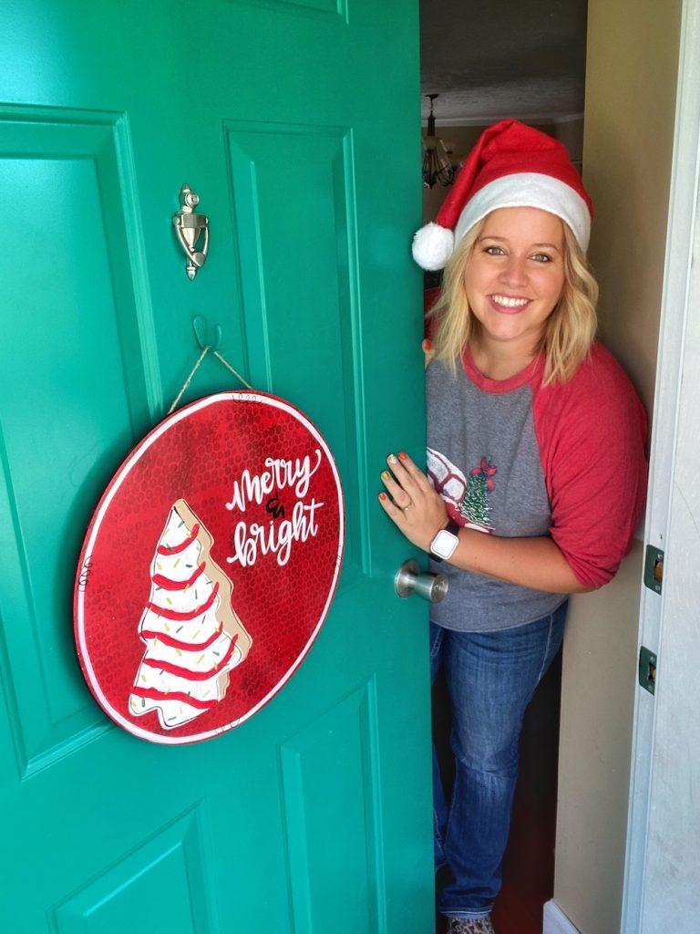 Tamara with the Christmas Snack Cake Door Hanger on her front door