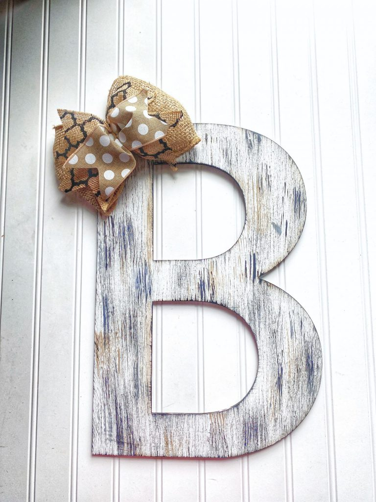 Wooden letter rustic painted with a burlap bow